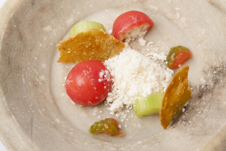 Compressed crab with tomato, horseradish granita and crab tuile