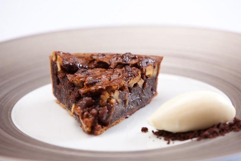 Dark chocolate and walnut tart with crème fraîche ice cream