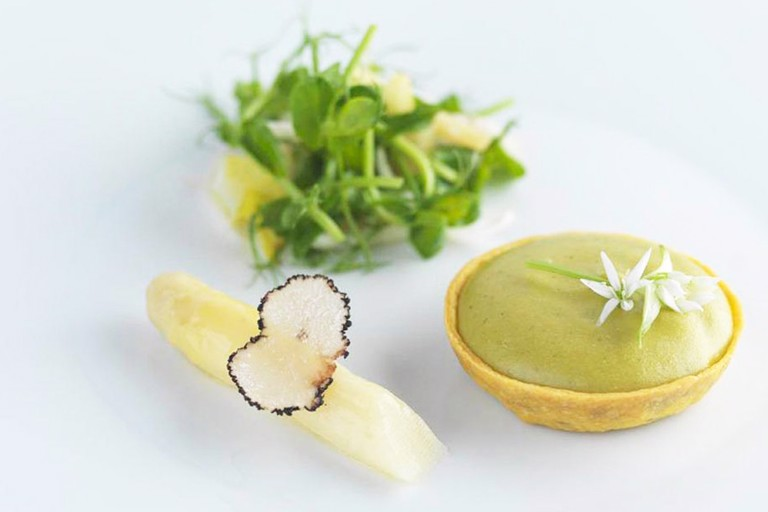 Parmesan and wild garlic tart with lemon, chicory and pea sprouts