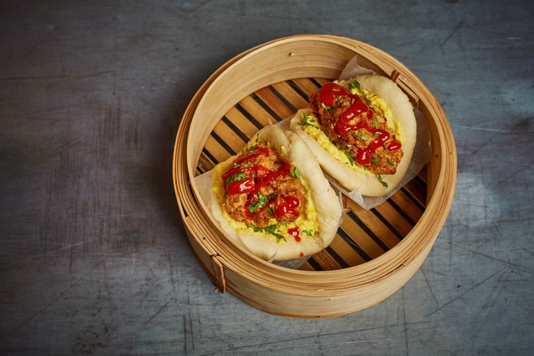 Southern fried chicken bao buns with creamed corn and hot sauce