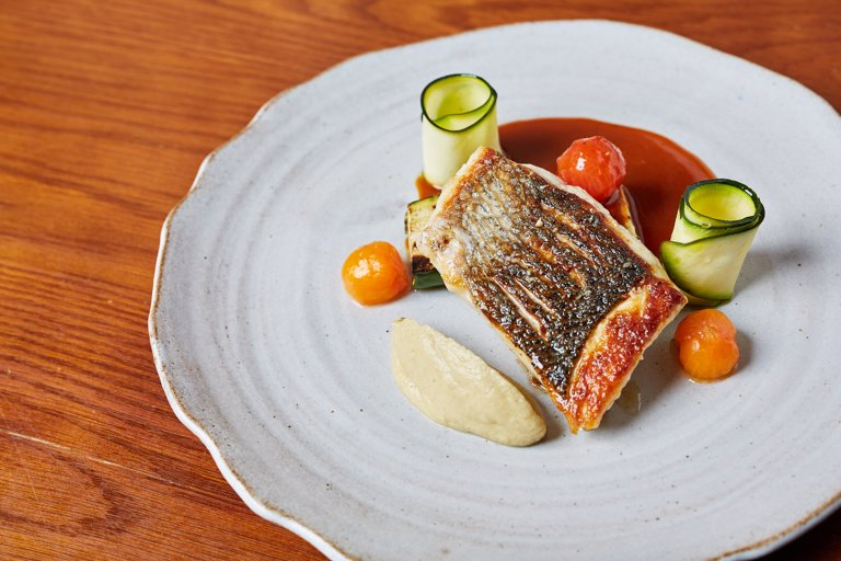 Wild bass with smoked aubergine purée and bouillabaisse sauce