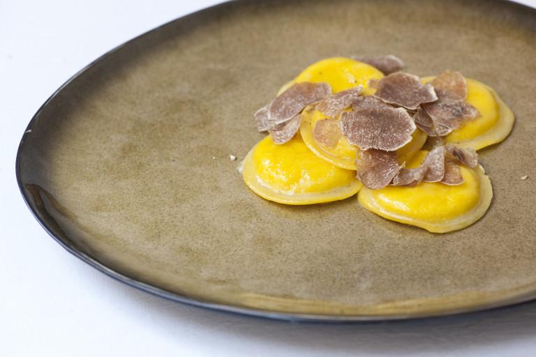 Egg yolk ravioli with truffle and Parmesan