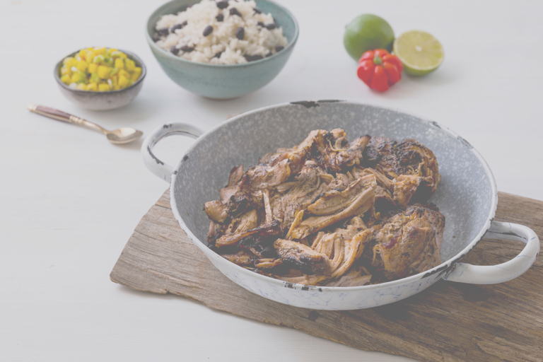 Jerk pork shoulder with mango salsa and rice and peas