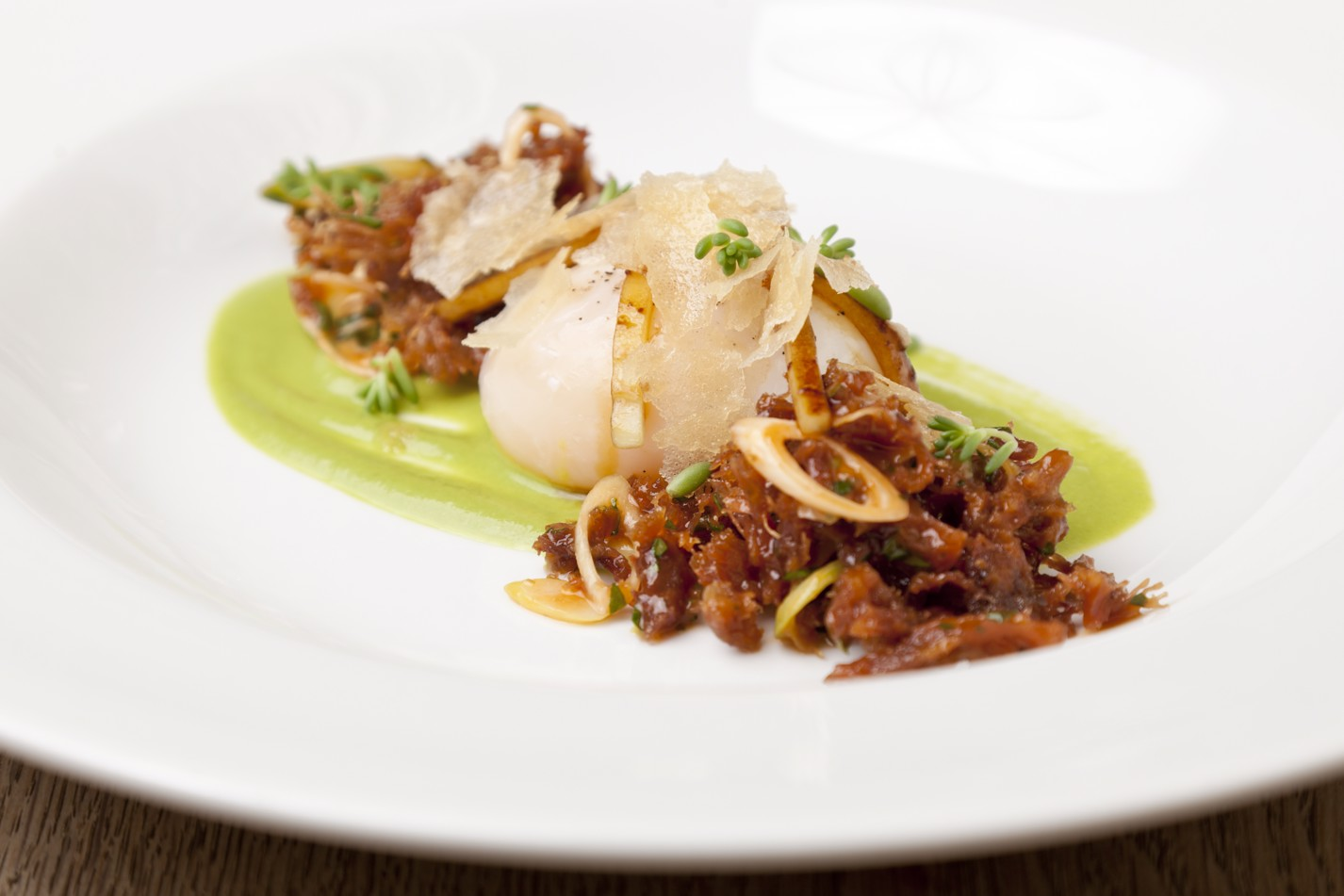 Slow-cooked duck egg with Peking-style leg meat, spring onion purée, cucumber, pancake crumb
