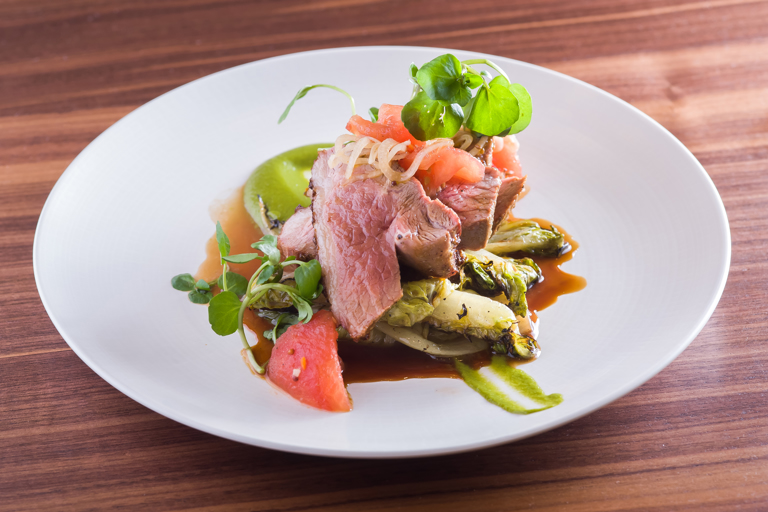 Amchur and fenugreek lamb rumps with leek purée and pickled tomatoes