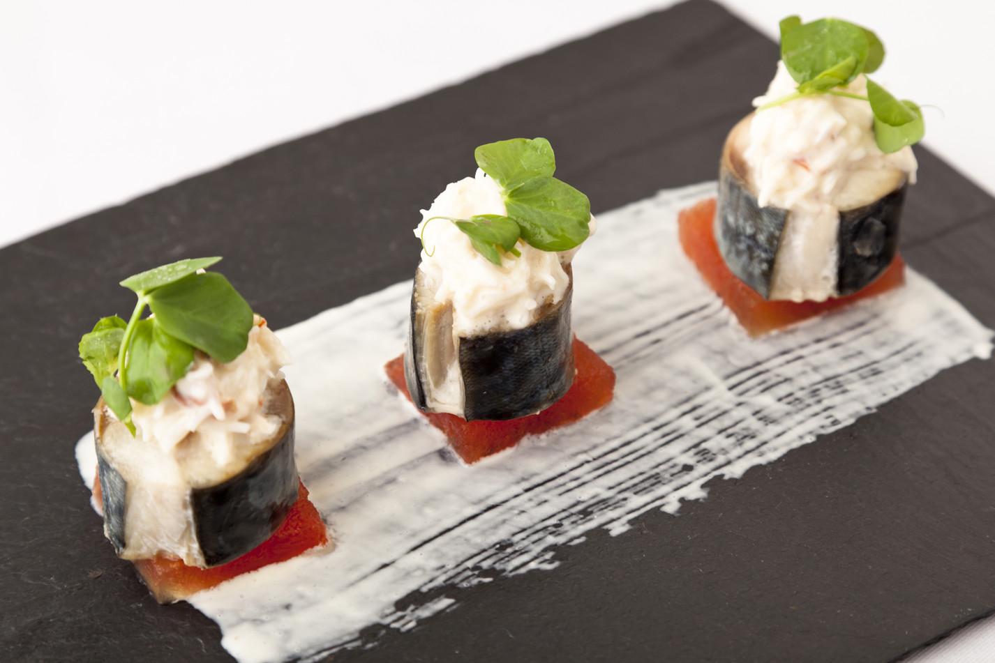 Mackerel with compressed watermelon, crab and horseradish salad