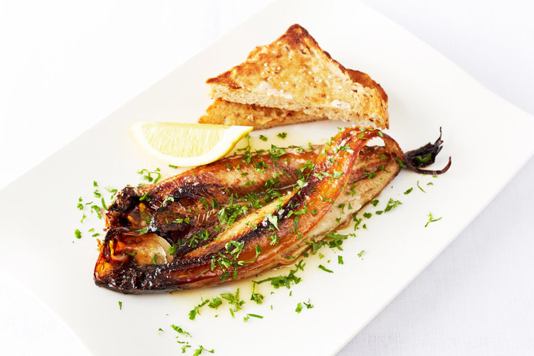 Grilled kippers, brown butter and parsley