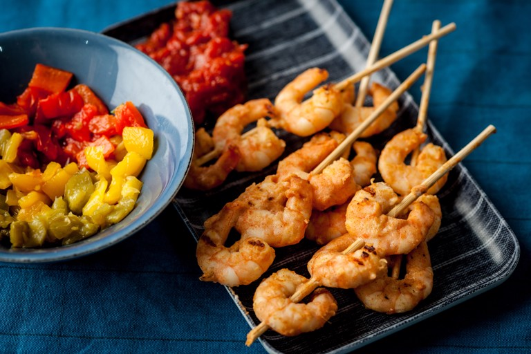 Prawn skewers with tomato chutney and roast peppers