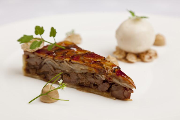 Glazed 'tart' of pig cheeks and penny bun, roasted celeriac, pear sorbet and wild cress