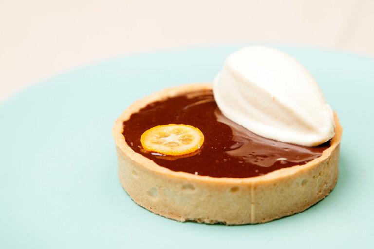 chocolate tart with kumquats and bergamot ice cream