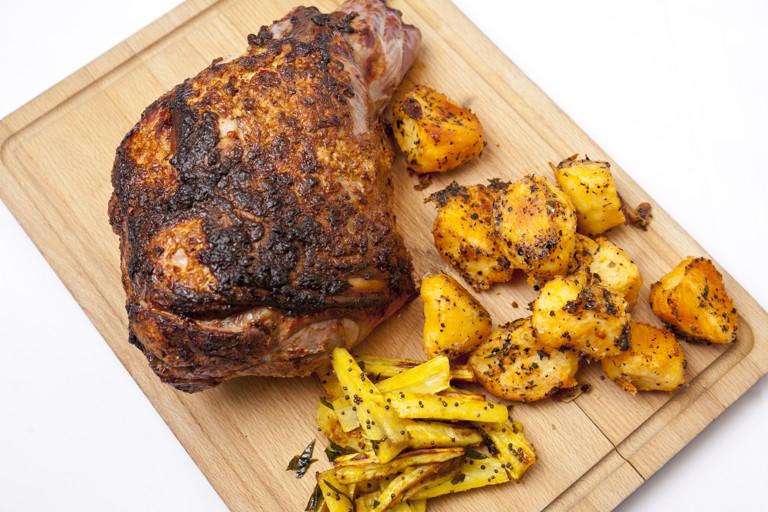 Roast leg of lamb 'aunty Soss's way' with spiced parsnips, carrots and crispy roast potatoes