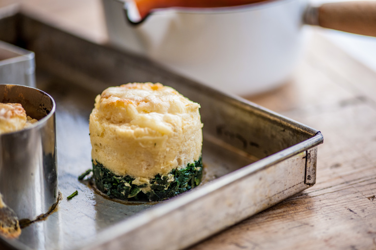 Smoked haddock soufflé with tomato, pepper and olive sauce