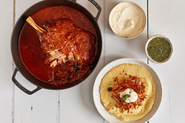 Slow cooked lamb shoulder with black mint sauce, chilli crème fraîche and tacosrecipe