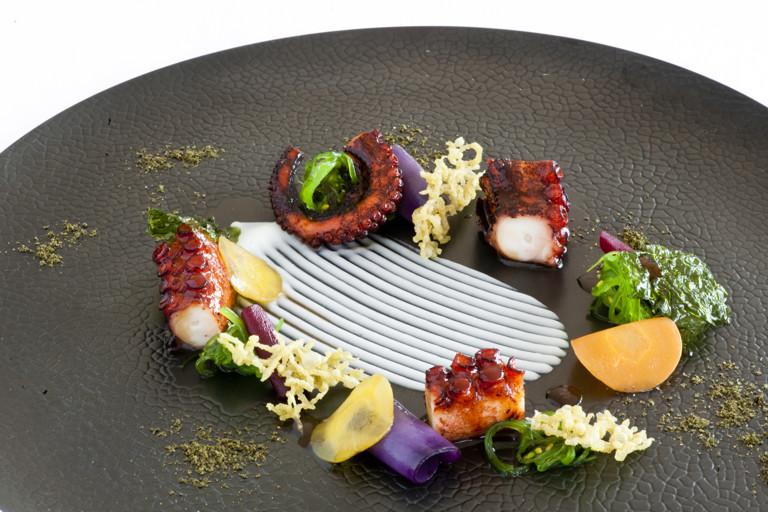 Glazed octopus with green tea tempura, Jerusalem artichoke cream, root and sea vegetables