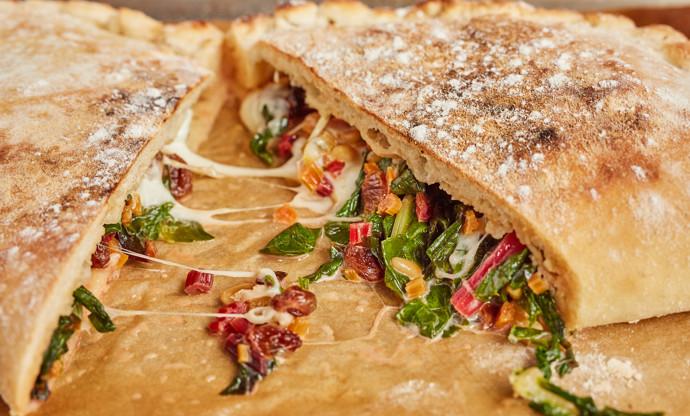 Calzone di verdura – Calzone of swiss chard, mozzarella, pine nuts and raisins