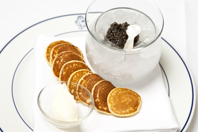 Ossetra caviar with blinis and sour cream
