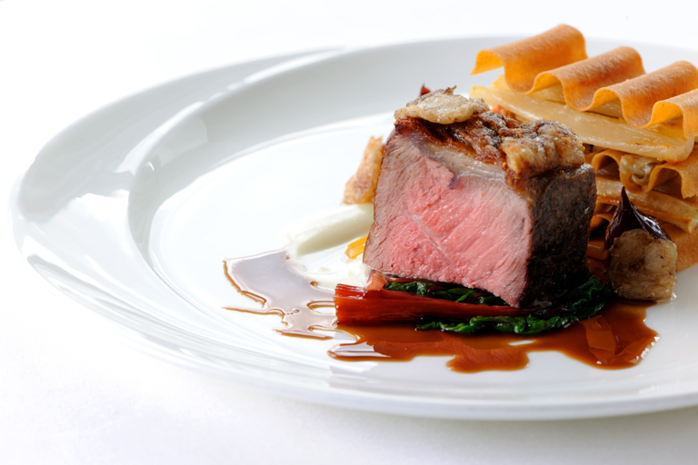 Roasted sirloin of beef with a bone marrow sauce, salsify, mushrooms and red wine shallots