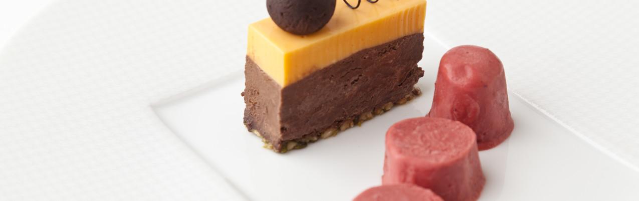 Whisky truffle, dark chocolate-chikki delice, orange mousse and cranberry kulfi