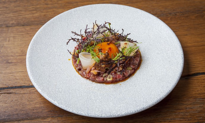 Beef tartare with soy-glazed egg yolk