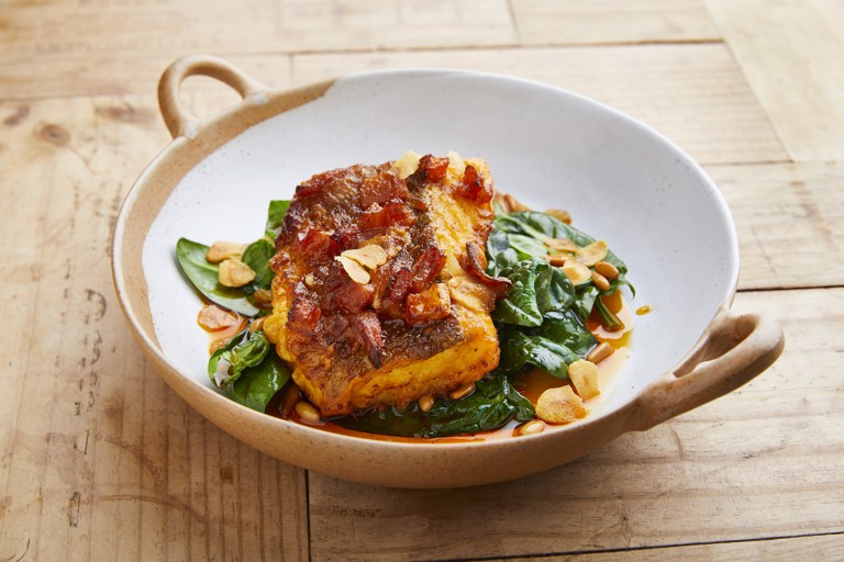 Cod with pimentón, spinach, pine nuts and raisins