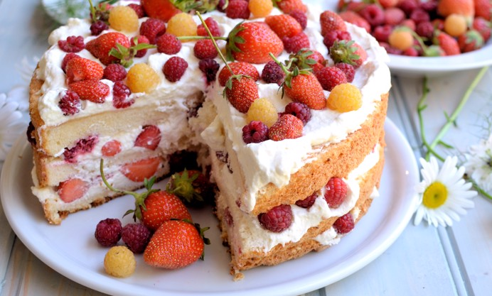 Decorate the top with cream, strawberries and raspberries