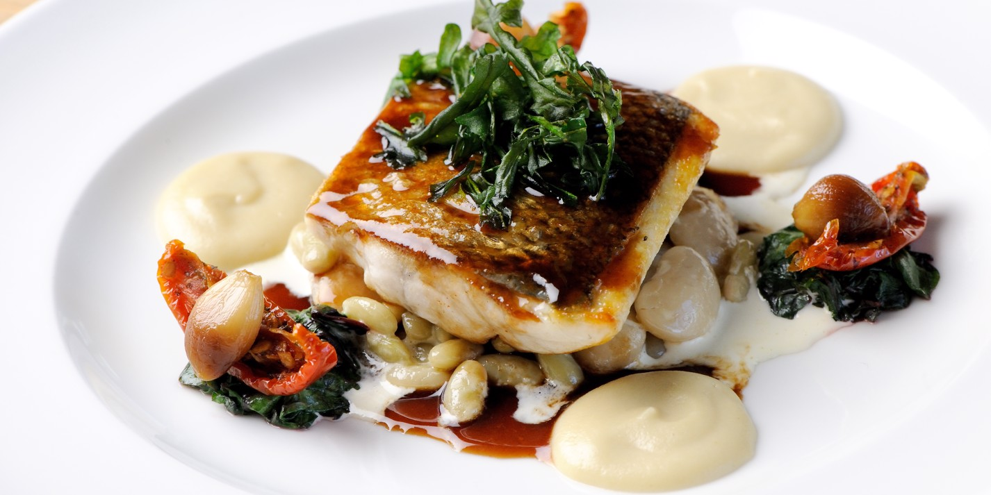 Sea bass with Jerusalem artichoke purée, roasted garlic and red wine