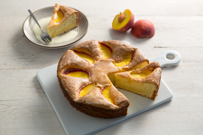 Olive oil cake with peaches and a lemon glaze