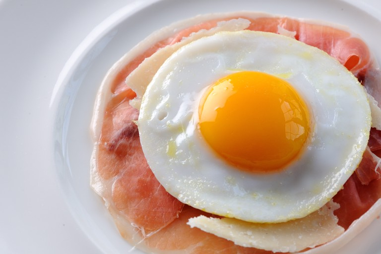 Air-dried ham with a fried duck egg and Parmesan