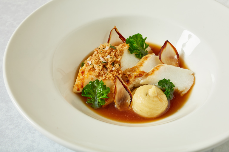 Skrei with chicken skin crumb and onion puree