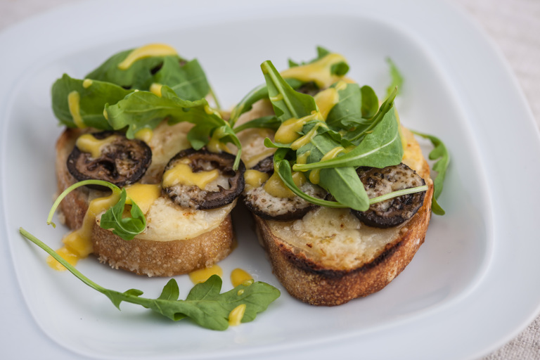 Grilled pear and pickled walnuts with cheddar on toast