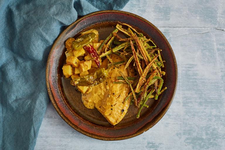 "Kerala-style sea bream and potato traybake with tangy okra ""chips"""