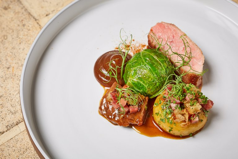 Pork with cabbage, Silesian dumpling and apple