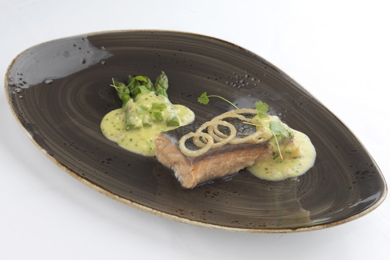 Steamed salmon fillet with asparagus spears and red onion hollandaise