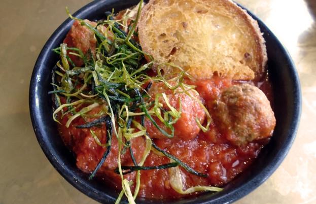 Ibérico pork meatballs in tomato and orange sauce