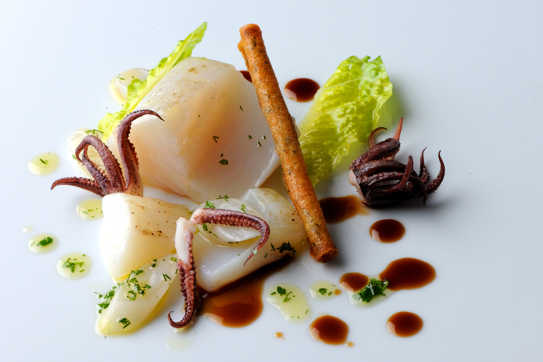 Salt cod poached in olive oil with langoustine cigars and hermitage jus