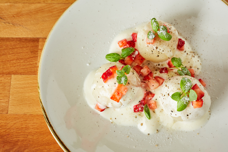 Strawberry and potato dumplings with basil and sour cream