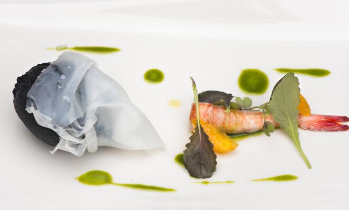Fried puff of squid ink stuffed with burrata, raw prawn, mandarin and tarragon oil