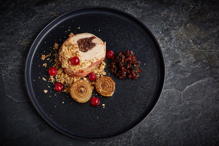 Turkey and black pudding ballotine with smoked bacon jam, onions, walnut crumble and pickled cranberries