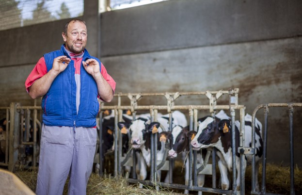 The dairy farmer explaining the feed
