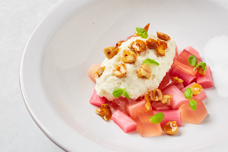 Rhubarb with cheesecake mousse and candied hazelnuts