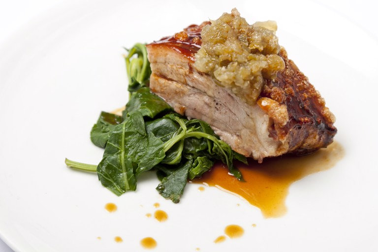 Slow-roast pork belly with green pepper relish