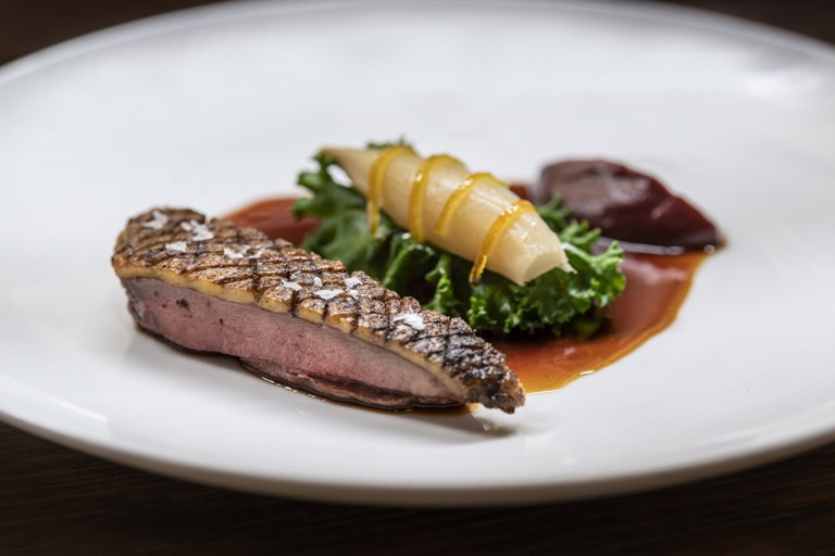 Duck with quince, endive and candied orange