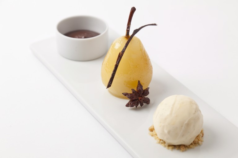 Spiced poached pears with hot chocolate sauce and vanilla ice cream