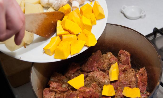 Add the potato and squash and start stirring