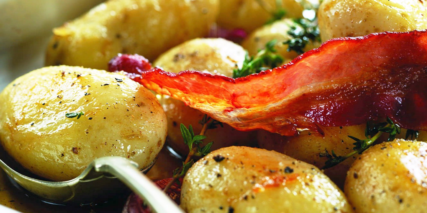 Maple syrup glazed new potato salad with crispy Pancetta and squid