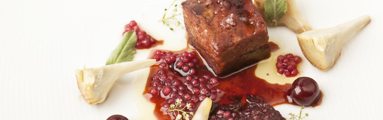 Pork secretos with artichokes and red wine tapioca