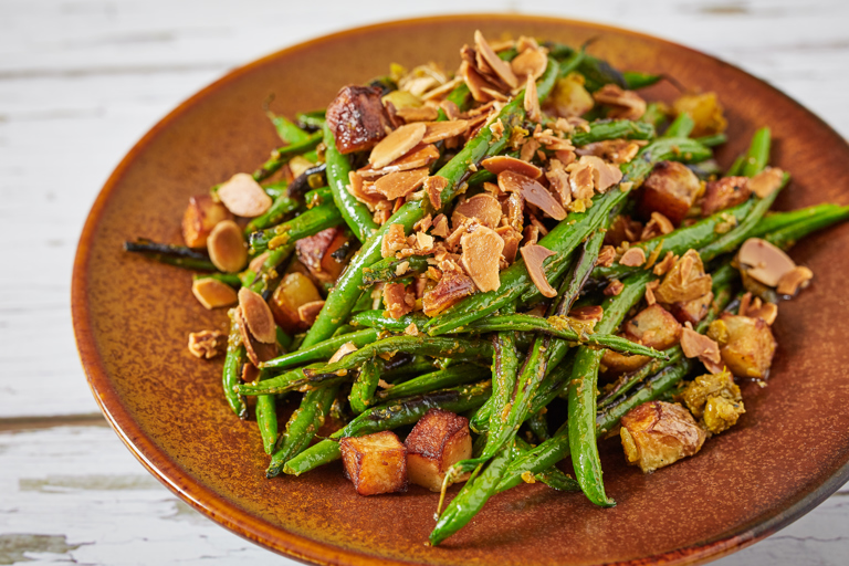 Charred green beans with sauté potatoes, chermoula and fried almonds