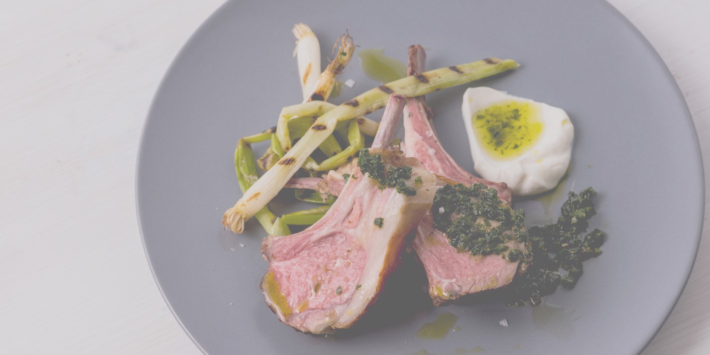 Sous vide rack of lamb with zhug, buttermilk and grilled spring onions