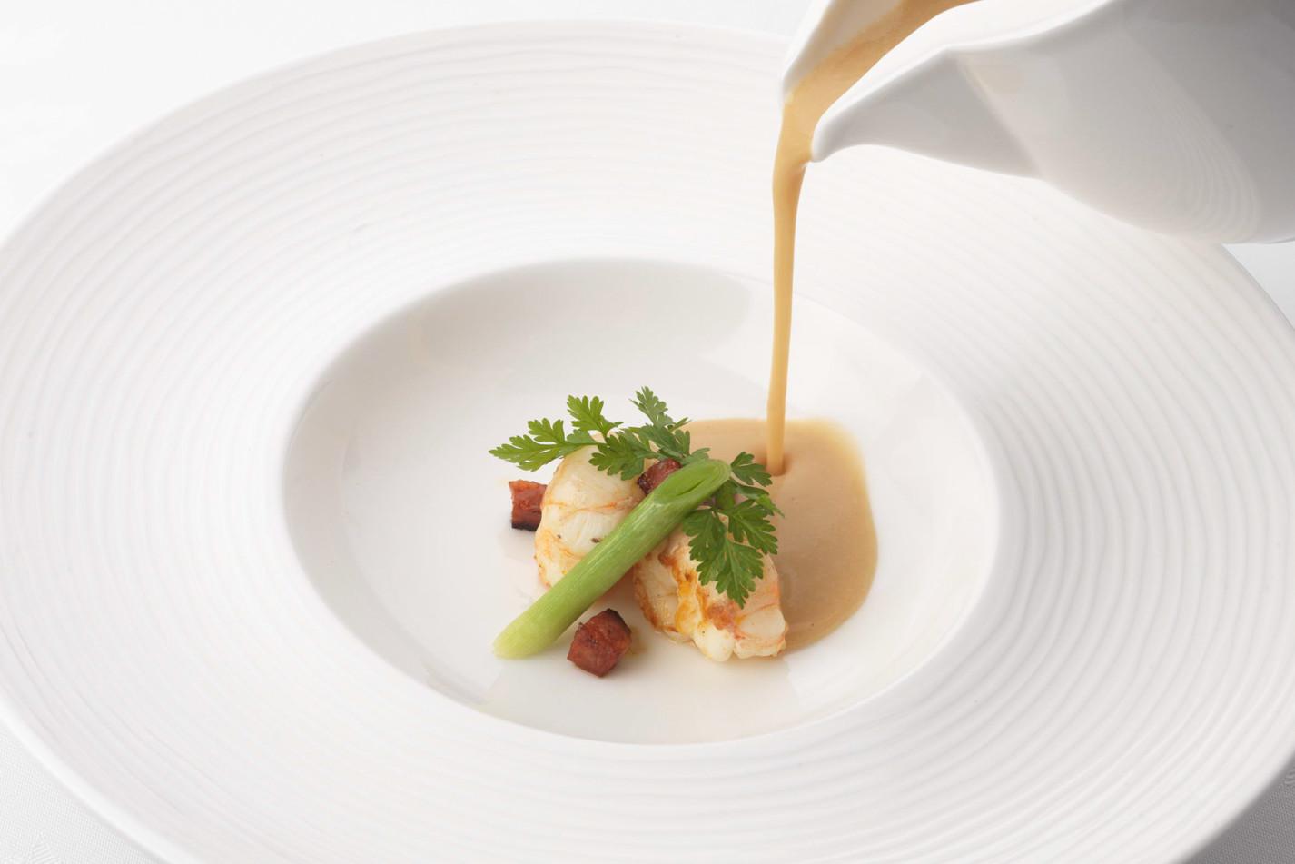 White bean velouté with chorizo and langoustine
