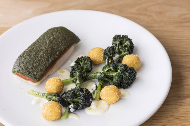 Grilled pollock with wild garlic crust and tomato fondue